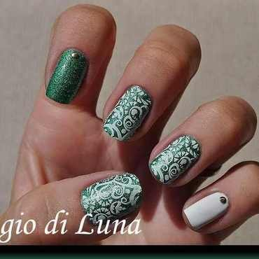 Stamping: White floral pattern on green nail art by Tanja