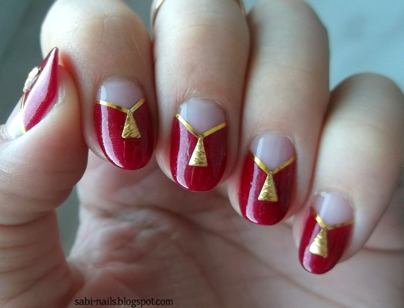 Red nails with triangle studs nail art by Sabina