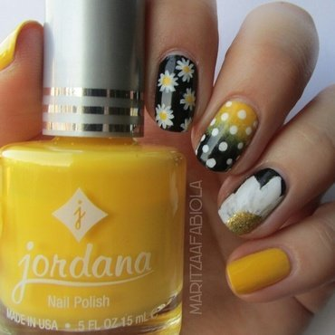 Yellow and black nail art by Mary