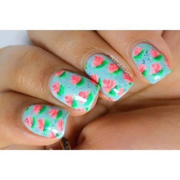 free hand flowers in water using ONLY polish. nail art by ketaki thatte
