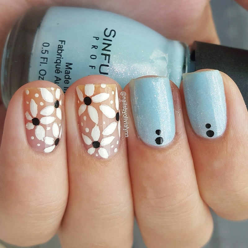 Negative Space Flowers nail art by Olivia D.