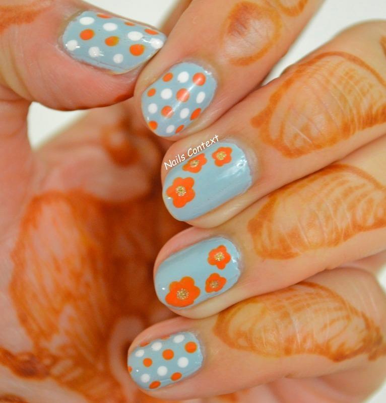 Blue and Orange  nail art by NailsContext