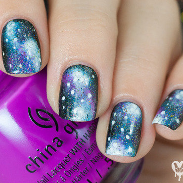 Galaxies nail art by Lacquered Obsession
