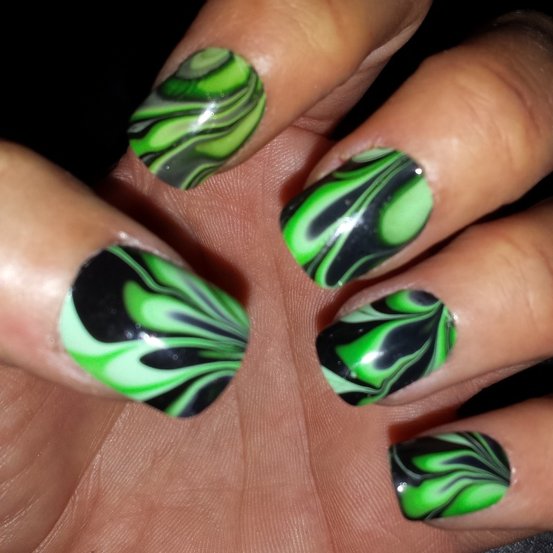 Black and green water-marbled nails nail art by Teena Breedon ...