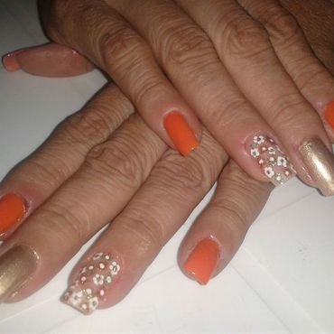 the orange  flowers nail art by Andreea