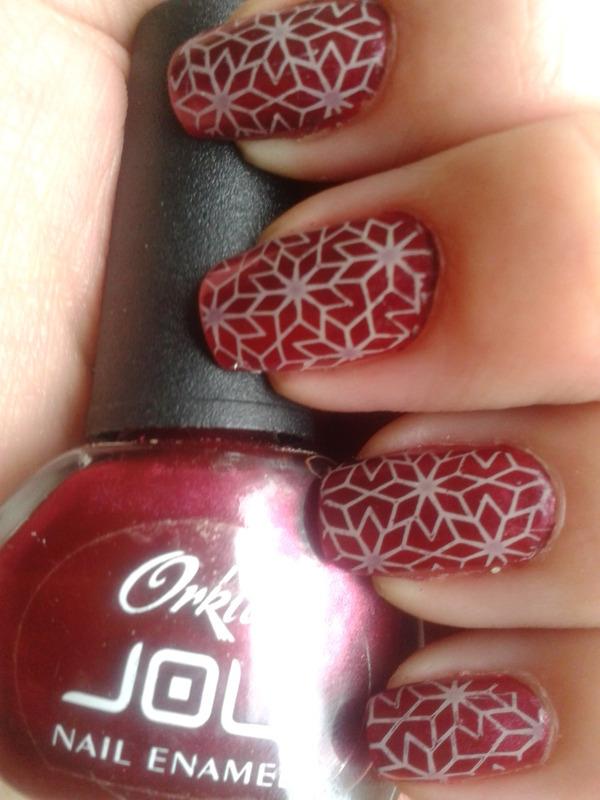 Beige ornaments on dark metallic red nail art by Jájis