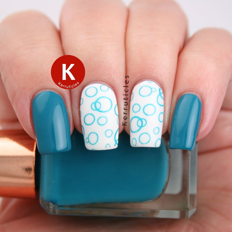 Teal circles nail art by Claire Kerr