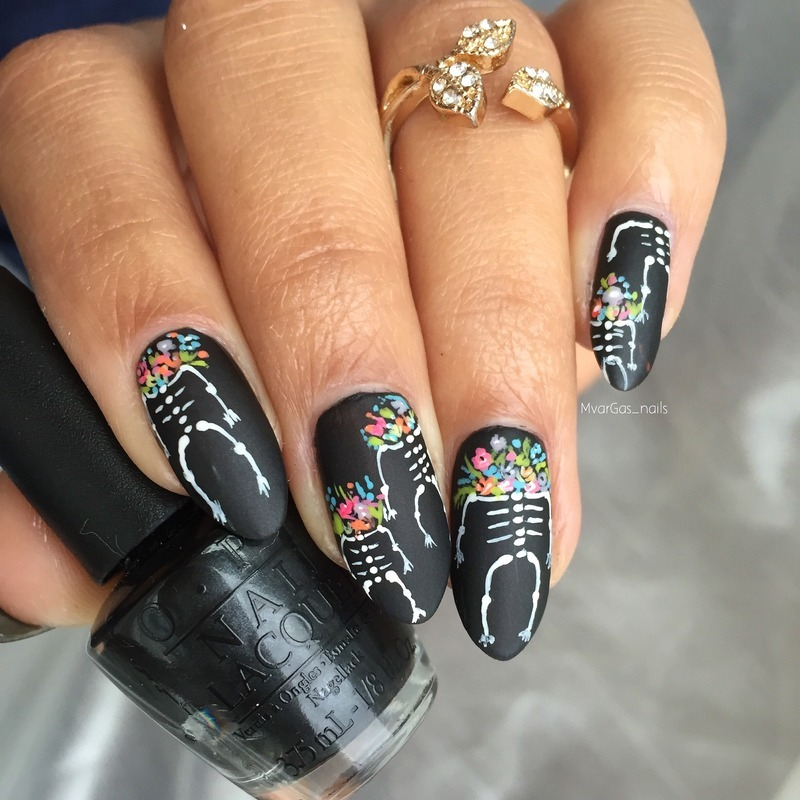 Skeletons and flower heads nail art by Massiel Pena