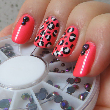 Pink leopard with studs nail art by Emelie J