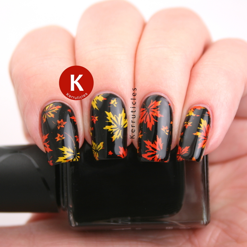 Autumn leaves on black nail art by Claire Kerr