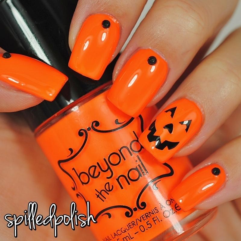 Pumpkin Face Nails nail art by Maddy S