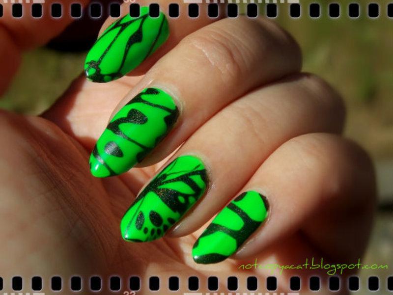 A neon butterfly nail art by notcopyacat
