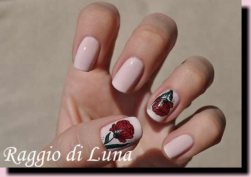 Red flower on light pink nail art by Tanja