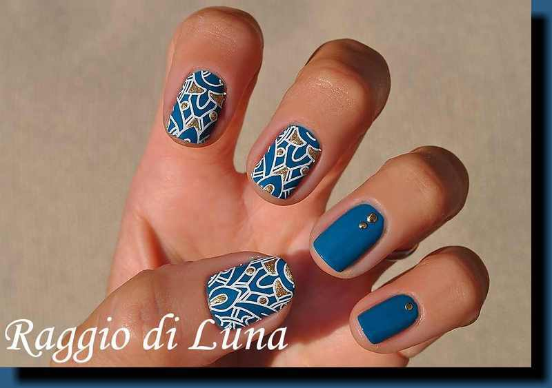 Stamping: White abstract pattern on teal nail art by Tanja