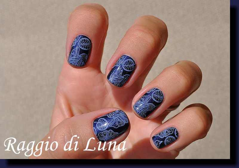 Stamping: Light purple floral pattern on inky blue nail art by Tanja