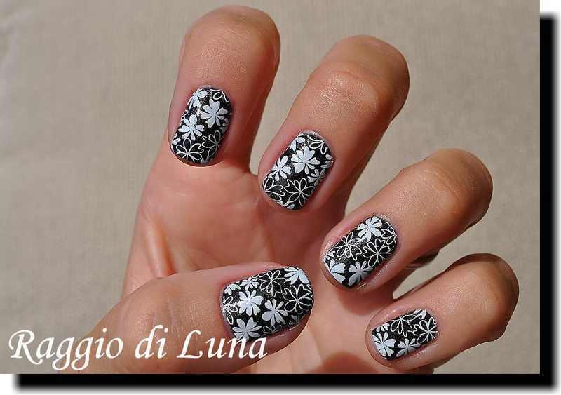 Stamping: White flowers on black nail art by Tanja