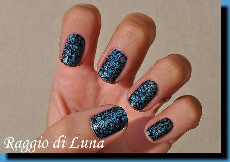 Stamping: Black floral pattern on blue holo nail art by Tanja