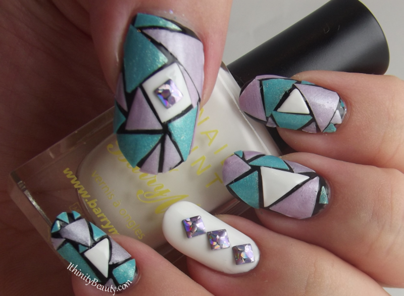 Cut Up Triangles nail art by Ithfifi Williams