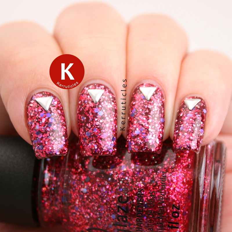 Pink and multicoloured glitter with triangular studs nail art by Claire Kerr