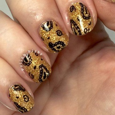 Black Paisley over Gold Glitter nail art by Crystal Bond
