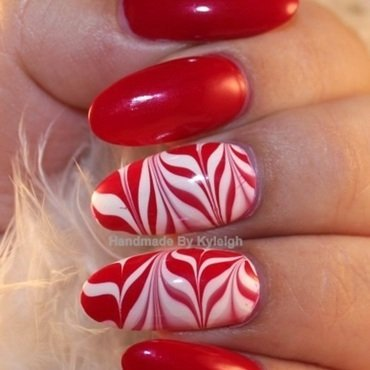 Candy Canes nail art by  Kyleigh  'Handmade By Kyleigh'
