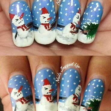 Snowmen pulling a tree to set it for christmas nail art by Divya Pandey