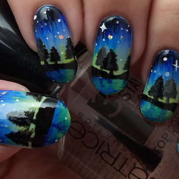 Freehand Northern Lights nail art by Ithfifi Williams