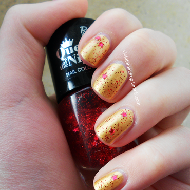 Gold with red stars nail art by Raindrop