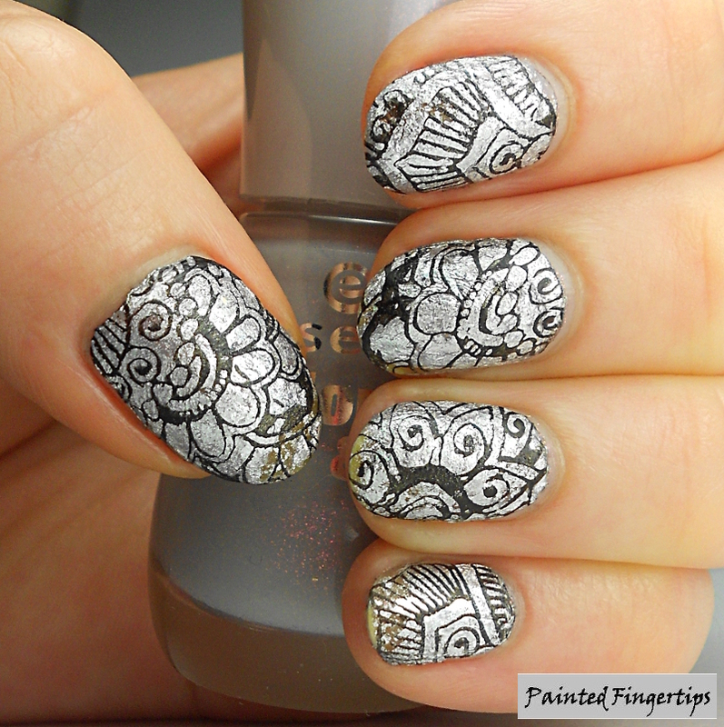 Stamping over sparkly foils nail art by Kerry_Fingertips