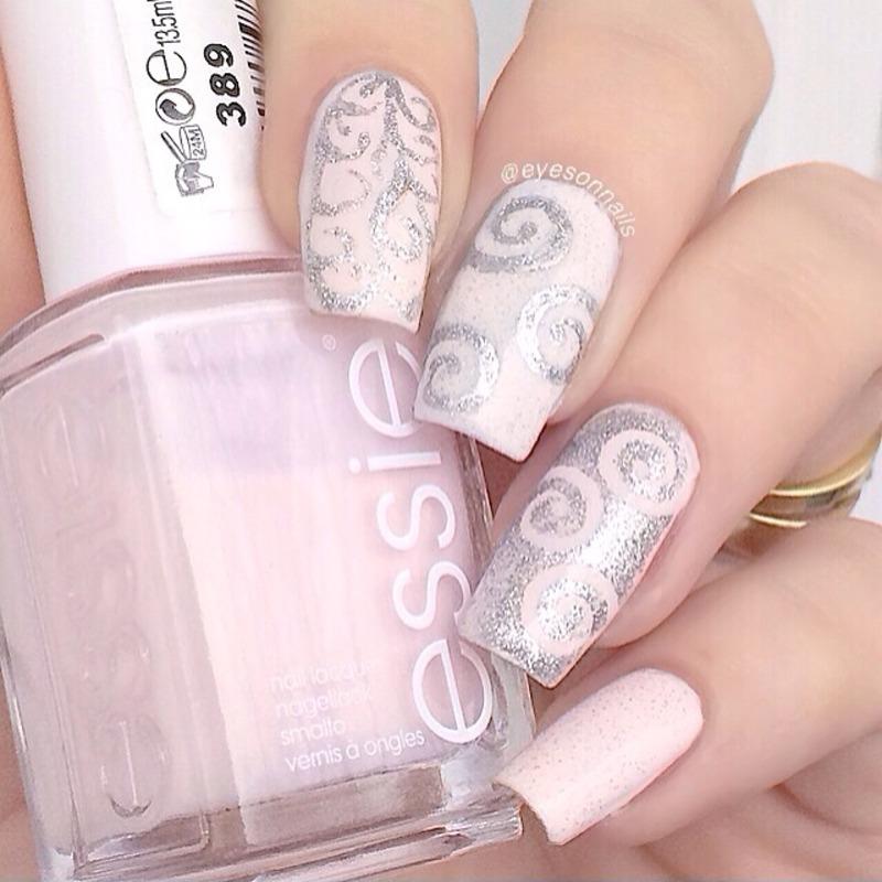Pale pink swirls  nail art by Virginia
