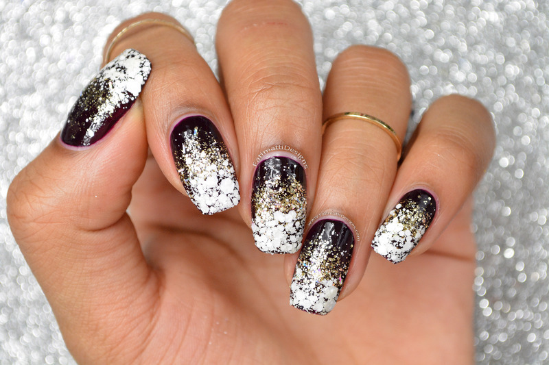 Holo Gold Glitter in a Blizzard nail art by Fatimah