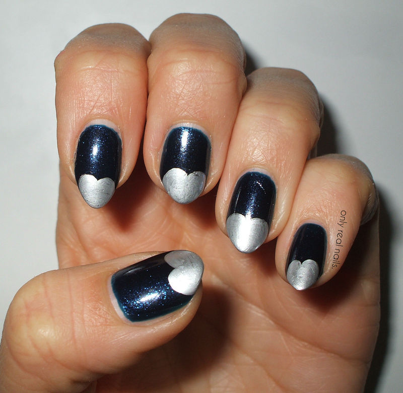 Silver hearts nail art by only real nails.