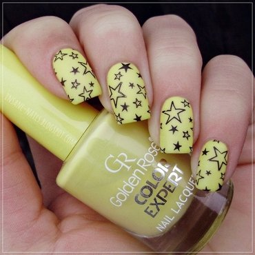 Yellow nails with black stars  nail art by Sanela