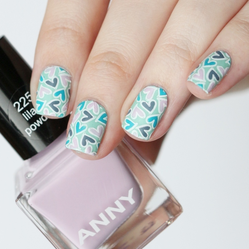 Little stamped hearts nail art by Annika