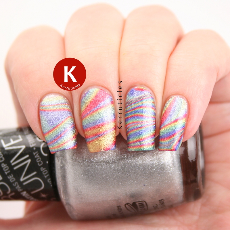 Rainbow water marble nail art by Claire Kerr