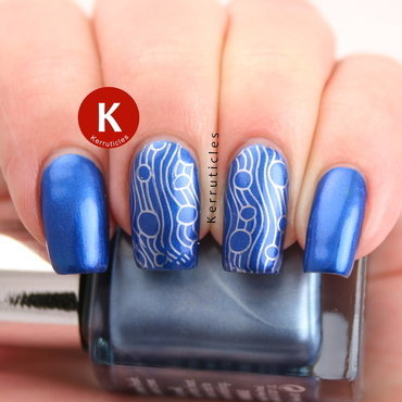 Metallic blue with wavy lines nail art by Claire Kerr
