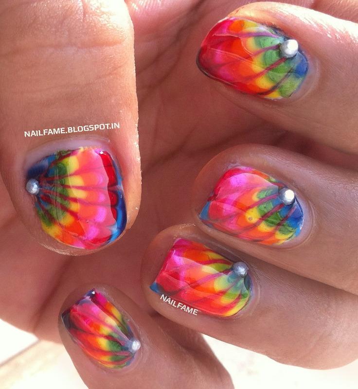 Dragged Rainbow Marble nail art by Nailfame