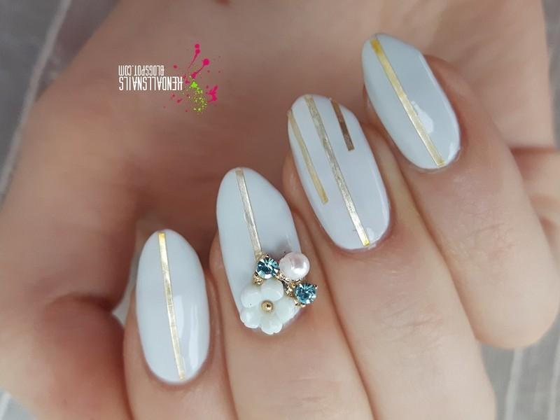 Gold stripes nail art by Julia Friedel
