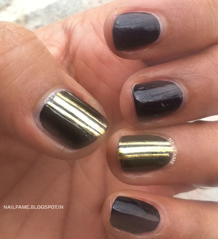 Black and Gold Nails nail art by Nailfame