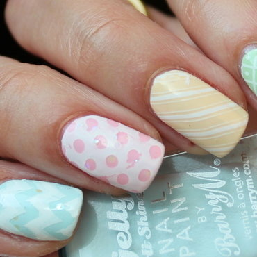 Easter eggs in pastel colors nail art by Polished Polyglot