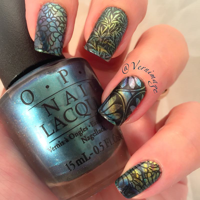 Stamping over watermarble mani nail art by Vernimage