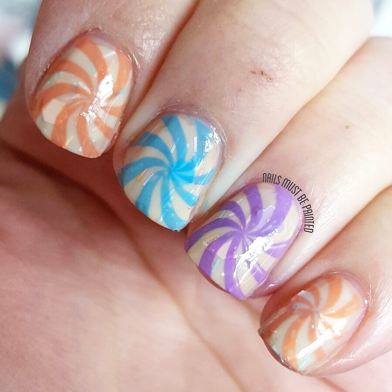 Swirling Sweeties nail art by Emily