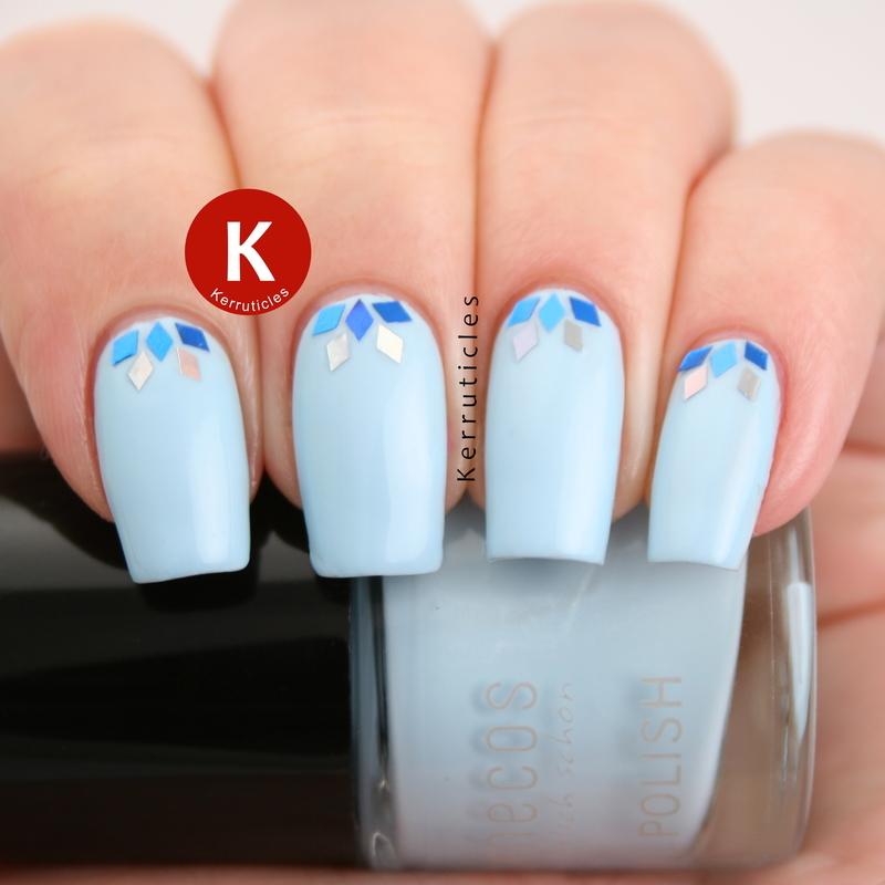 Blue diamond glitter half moons nail art by Claire Kerr