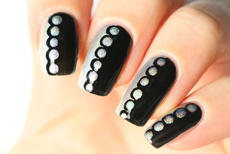 Two polishes and a dotting tool nail art by Tribulons