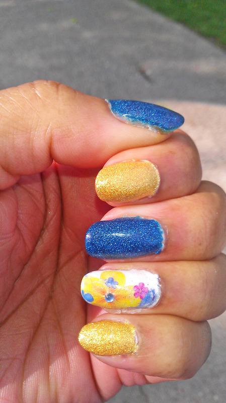 Blue and Yellow nail art by Jackie Bodick