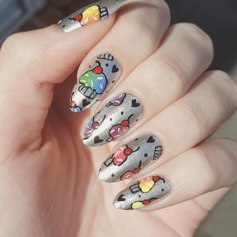 Freehand rainbow cupcakes  nail art by Alexandra