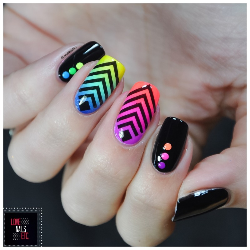 Geometric rainbow nail art by Love Nails Etc