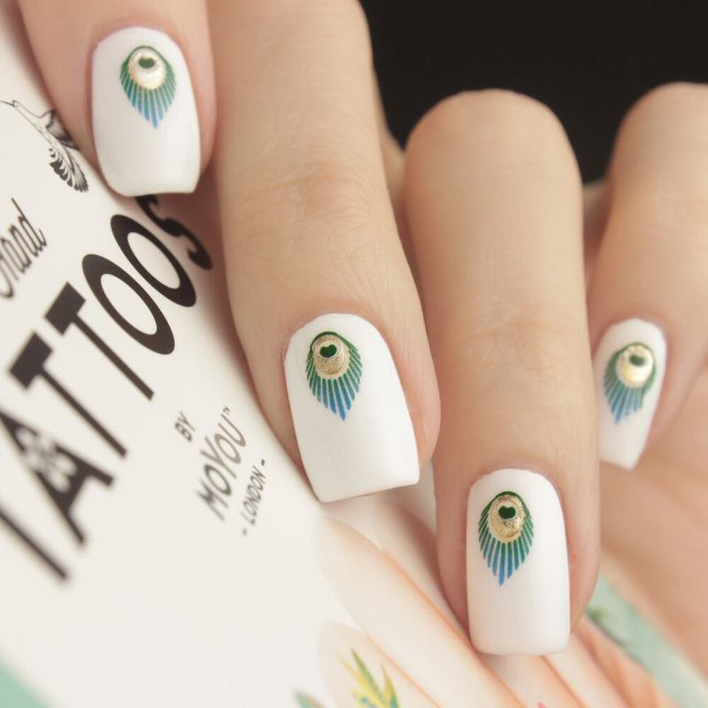 Peacock nail art by Tine