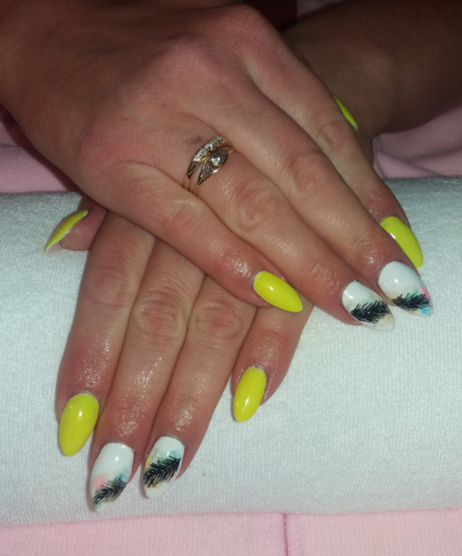 Neon yellow and feather with blur effect nail art by Magda