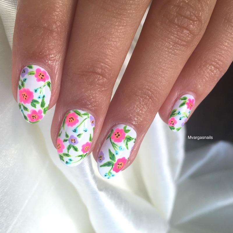 Floral heaven  nail art by Massiel Pena